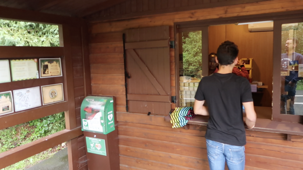 Getting the breakfast basket from a cabin at Davy Crockett Ranch